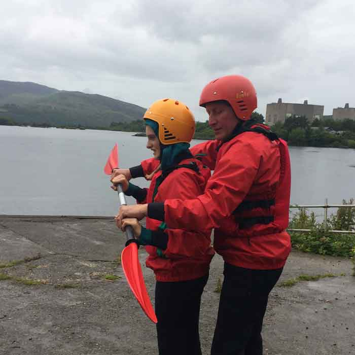 Getting lessons from daddy at Trawsfynydd Lake Centre about kayaking